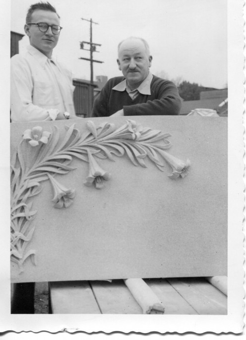 Justin Ast and his father Edmund Ast display a carving of a spray of flowers intended for a gravesite.