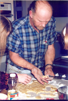 Grandpa making Christmas cookies