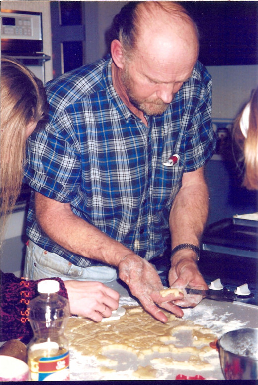 Grandpa making Christmas cookies