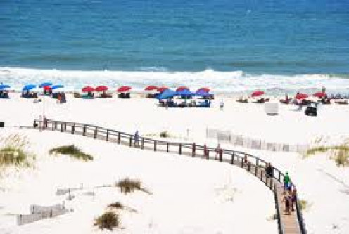 Gulf Shores, Alabama is a beach on the Gulf Coast with sandy, white beaches for miles. It's fun to play in the sand or play in the ocean waves all day.