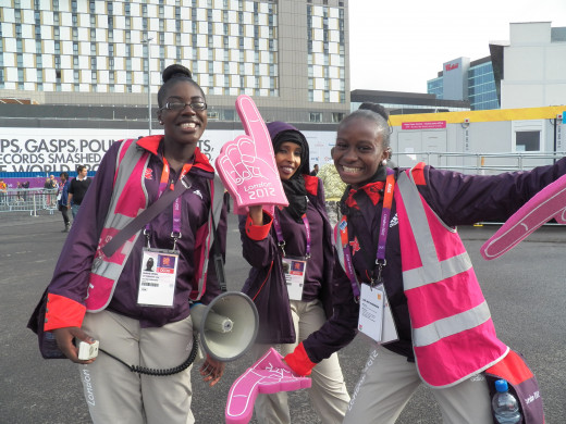 Who could forget the cheerful, bubbly volunteers with their funny antics and their big pink foam hands? 'This Way'.