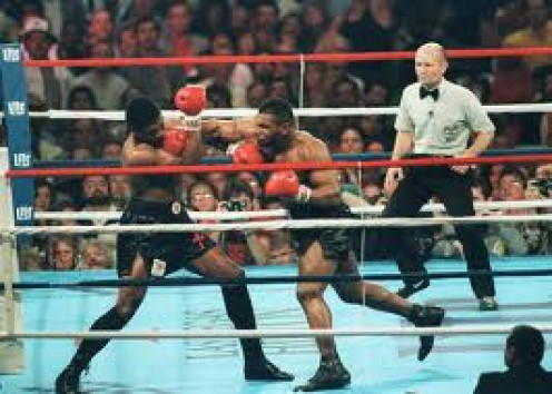 Mike Tyson knocks out Trevor Berbick in two rounds to become the youngest heavyweight champion in boxing history.