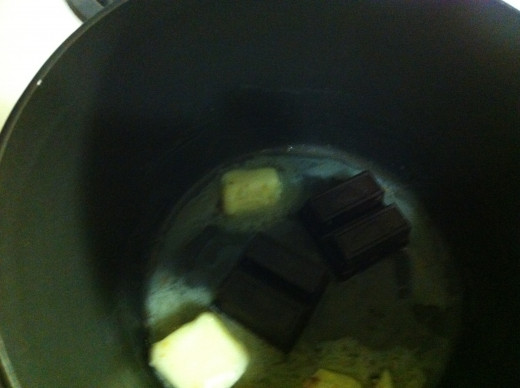 Melt and stir together butter and chocolate squares.