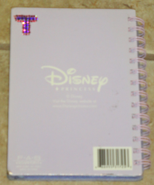 Here, I monogrammed the back of my autograph book (which is a journal given to me as a gift years ago) with some Swarovski flatbacks in purple and pink. But you can use acrylic ones in place of them if cost and/or kid safety is a concern.