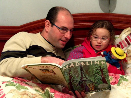 Reading aloud to children teaches them early literacy skills.