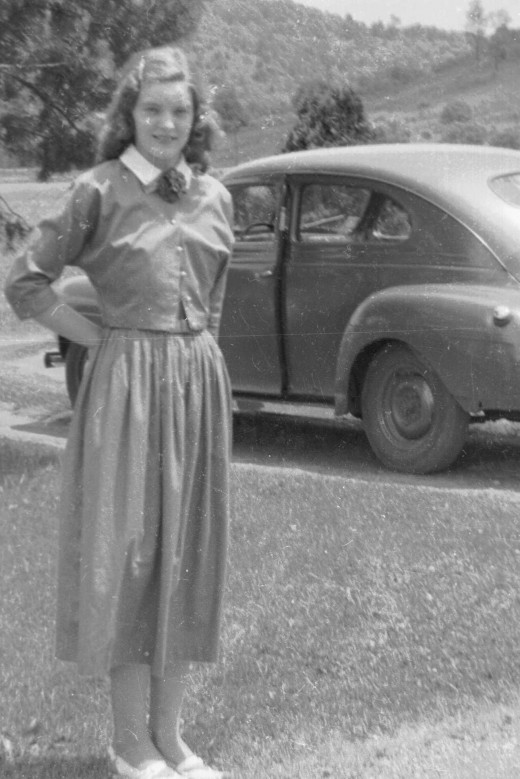 My lovely mother standing in front of her car.