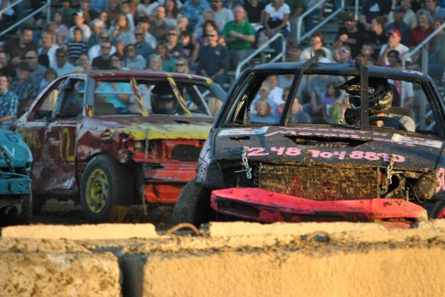 Keeping away from the barriers, which this driver is not doing, is important during a demo derby. It's easy to get stuck on a barrier.