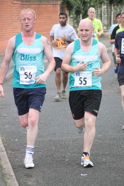 Grab Yourself A Running Buddy To Help Your Progress Towards Your Performance Goals. These Guys Were Helping Each Other During The 2012 Wolverhampton Marathon