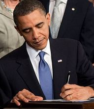 """President Barack Obama Signing """"The Patient Protection and Affordable Care Act of 2010"""" into law."""
