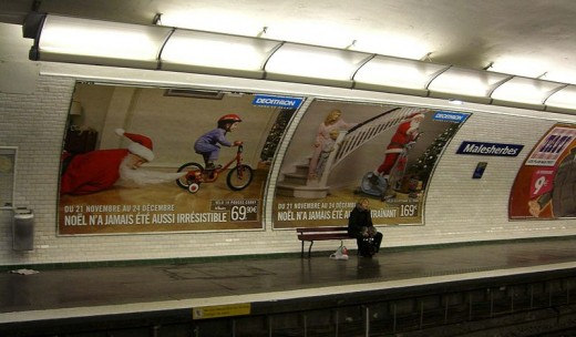Funny Christmas poster in Paris subway
