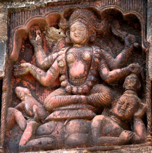 Kali sitting on reclining Shiva; Bonkati