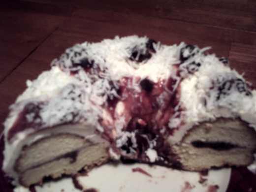12. Organic Blueberry syrup mixed with real blueberries and preserves filled in the middle and dribbled over white confectioners sugar icing made with butter and the flaked with cocoanut-always in the cupboard for Mr. Cocoanut Lover.
