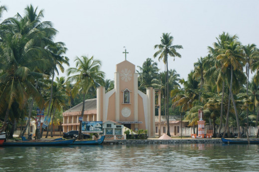 A church on the banks of Alappuzha back waters