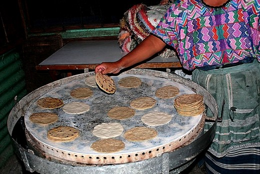 Cooking tortillas on a large comal in Guatemala