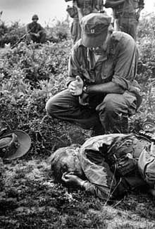 Photographer Henri Huet image of Chapelle receiving her last rites.  Huet would also die in Vietnam in 1971.