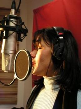 Sylvie recording at the studio