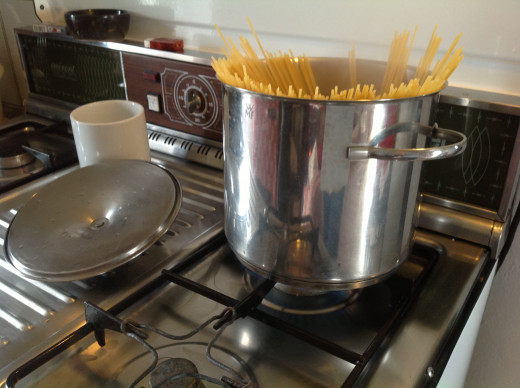 Spaghetti cooking in the pan