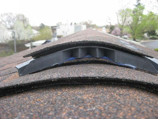 Ridge vents allow heat to escape instead of contributing to ice dam formation. They work in conjunction with soffit vents.