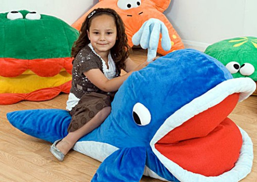 A girl on her large animal floor pillow