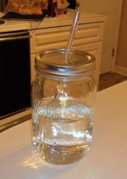 Mason jar with a hole for a straw.