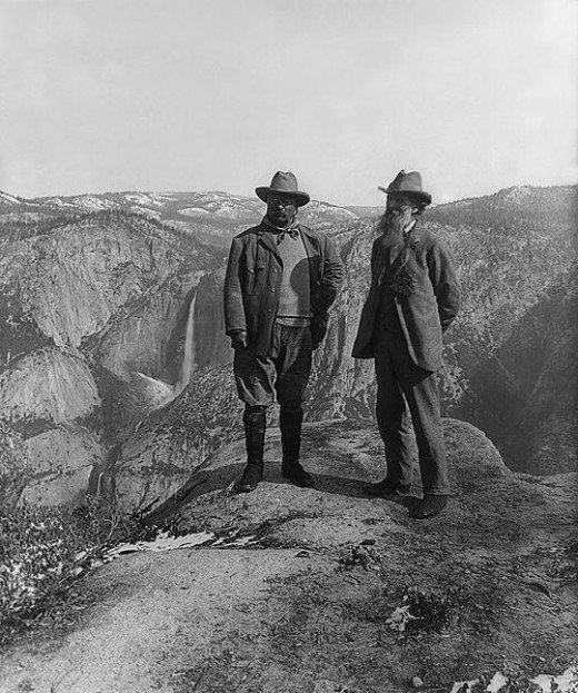 U.S. President Theodore Roosevelt (left) and nature preservationist John Muir were photographed on Glacier Point in Yosemite National Park in 1906. Upper and lower Yosemite Falls are in the background.