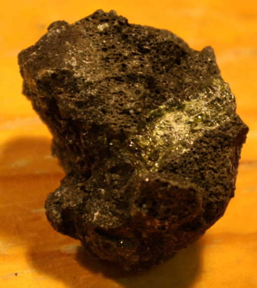Clinopyroxene crystal recovered from a volcanic rock sample.