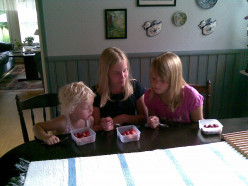 One important thing in life is to watch three cousins eat grandmother's strawberries.