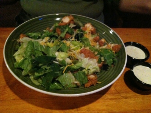 Chicken Salad at Applebees. Since their salads are so large, I always ask for a to-go box and immediately put half away for lunch the next day. Also forgo using both cups of salad dressing. It is soooo bad for you.