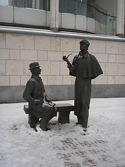 Statues of Holmes and Watson with what I hope is snow.