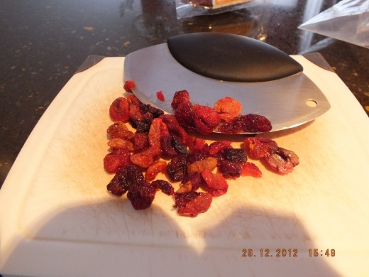Quick chop on the dried cherries. Did you know that all forms of cherries are excellent for treating gout?