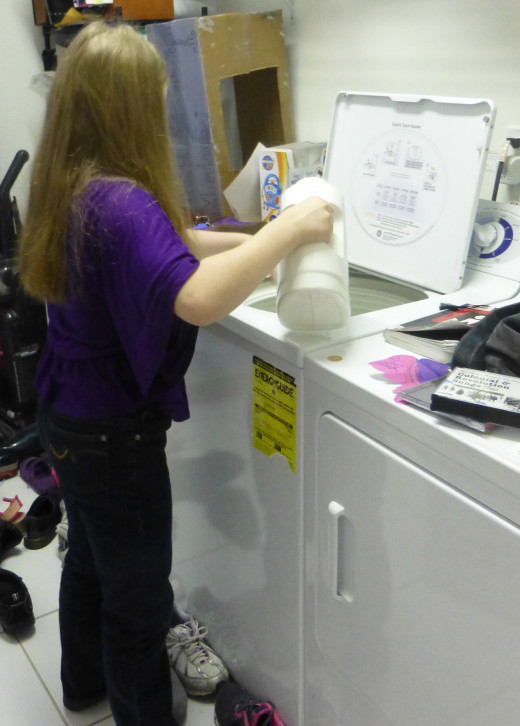 Nine-year-old daughter doing laundry