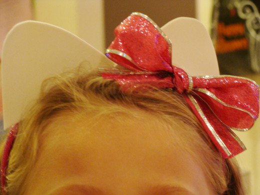 The hair and bow hide any imperfections from gluing the ears to the headband.