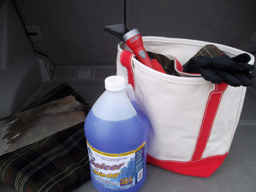 Keep a winter driving kit in the car with supplies to help remove snow and keep you warm