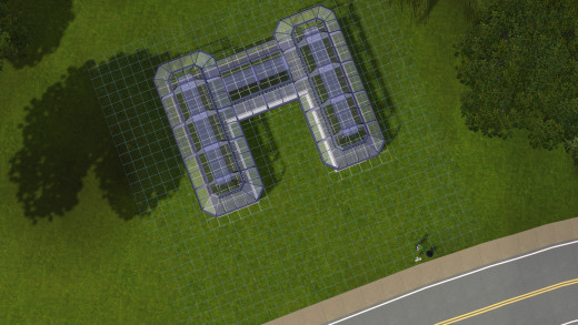 Aerial view of sims 3 greenhouse, showing how the roof becomes clear to allow the player to see in to the greenhouse.