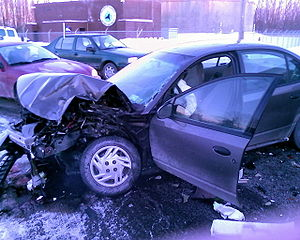 Front end destruction to a Saturn automobile - defensive driving can help you avoid having accidents like this one