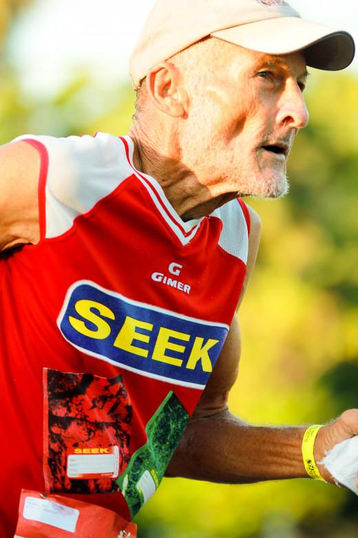 Roy Thomas runs heartily and convincingly at age 84 in Reggae Marathon & Half Marathon 2011. © Shutterwords