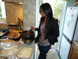 Naomi cooking the dish