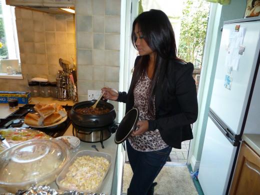 Naomi cooking the dish