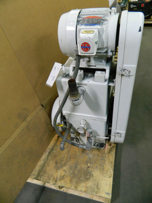 yes, mechanical pumps are often mounted like this. On a board or dolly for mobility.  Sometimes wood  sometimes metal.  Often connected with flexible vacuum hoses.  All this equipment must be removable... WHILE a particle accelerator remains operable
