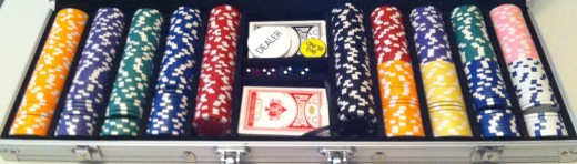 A full set of poker chips, with poker decks and dice included.