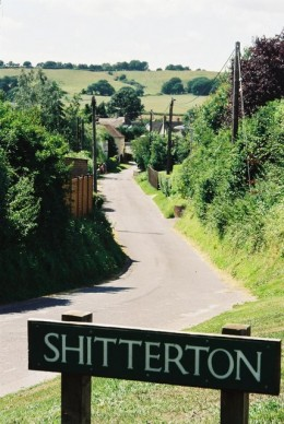 This approach road leads down to the picturesque hamlet of Shitterton.