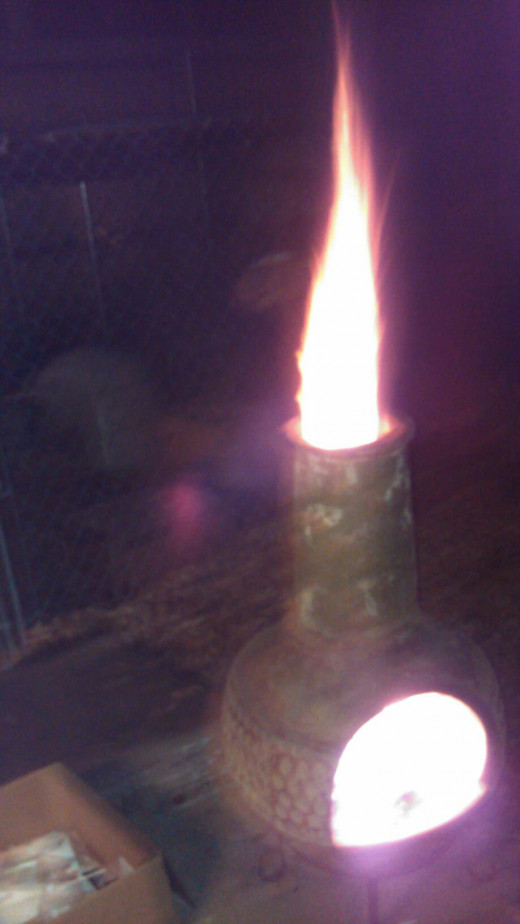 Yes, that is a flaming Chiminea.  Don't try this at home.
