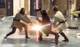 Qui-Gon Jinn (Liam Neeson) and Obi-Wan Kenobi (Ewan McGregor) battle Darth Maul (Ray Park) in the climactic battle in Star Wars Episode I: The Phantom Menace.