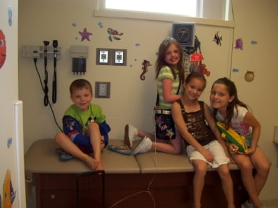 Rayni and her cousins making a visit to the doctor fun.  Cousins or not, Rayni, unless really feeling badly, was always laughing in the exam rooms while we waited for the doctors.