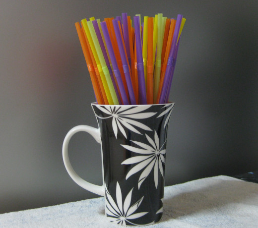 Drinking straw holder