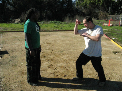 Glenn and Jamie demonstrate a Kenpo technique called Buckling Branch, against a Left Front Thrust Kick