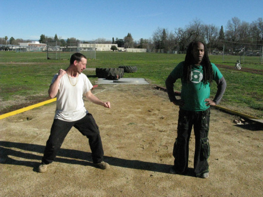 Jamie and Glenn demonstrate a Kenpo technique called the Back Breaker, against a surprise attack from the flank.