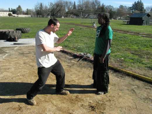 Jamie and Glenn demonstrate a Kenpo technique called Gathering Clouds.