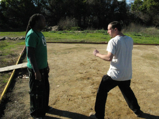 Glenn and Jamie demonstrate a Kenpo technique called the Dance of Death, against a right step-through thrust punch.