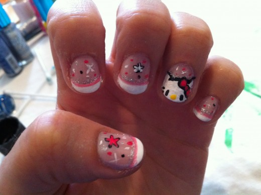 I love Hello Kitty!  Wish I had cleaned my nails up before I took this pic though.